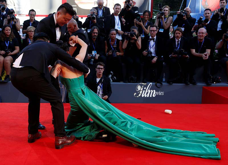 "A guest falls during the red carpet event for the movie ""The Light Between Oceans"" at the 73rd Venice Film Festival in Venice"