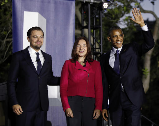 President Barack Obama, right, arrives with actor Leonardo DiCaprio, left, and Dr. Katharine Hayhoe, to talk about climate change as part of the White House South by South Lawn event on the South Lawn of the White House in Washington,Monday, Oct. 3, 2016. (AP Photo/Carolyn Kaster)
